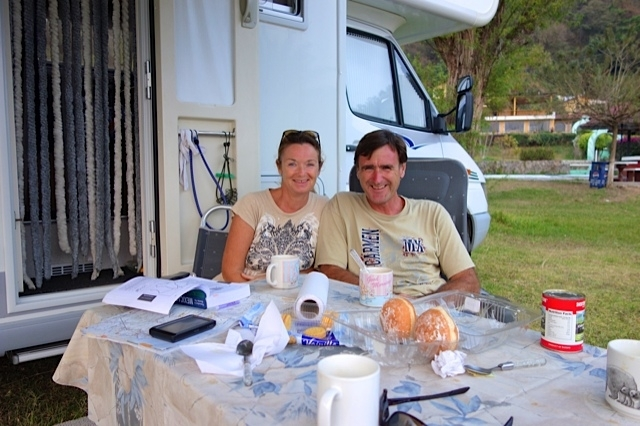 Uwe and Claudia at breakfast in front of their RV minus rear bumper